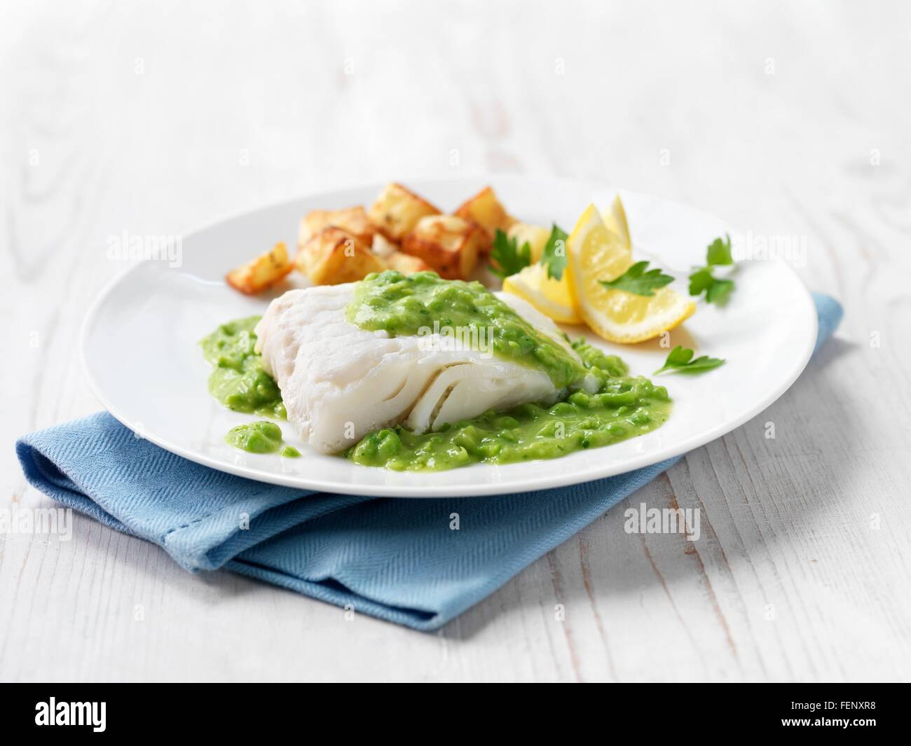 Haddock Fillet | Haddock Fillet With Fried Potatoes Minted Pea Sauce And Lemon