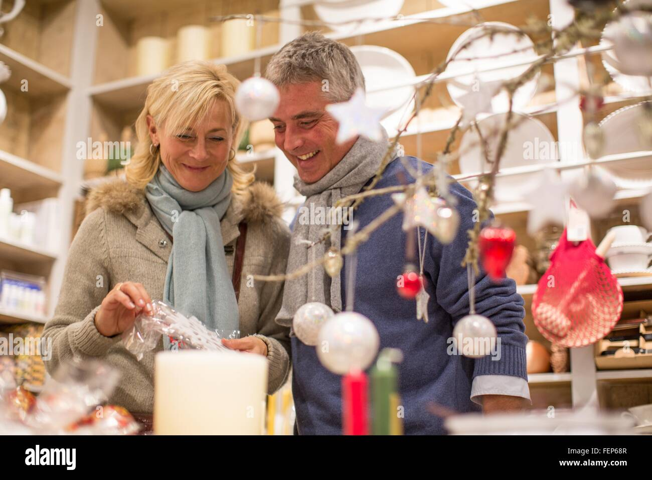 Decorations In Spain Mature Couple Browsing Xmas Decorations In Gift Shop Majorca