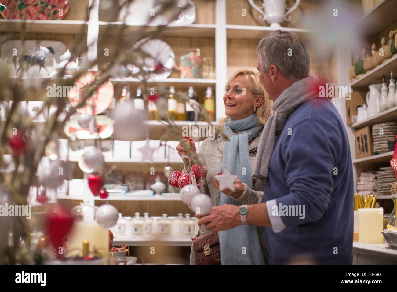 Decorations In Spain Mature Couple Browsing Star Decorations In Gift Shop Majorca