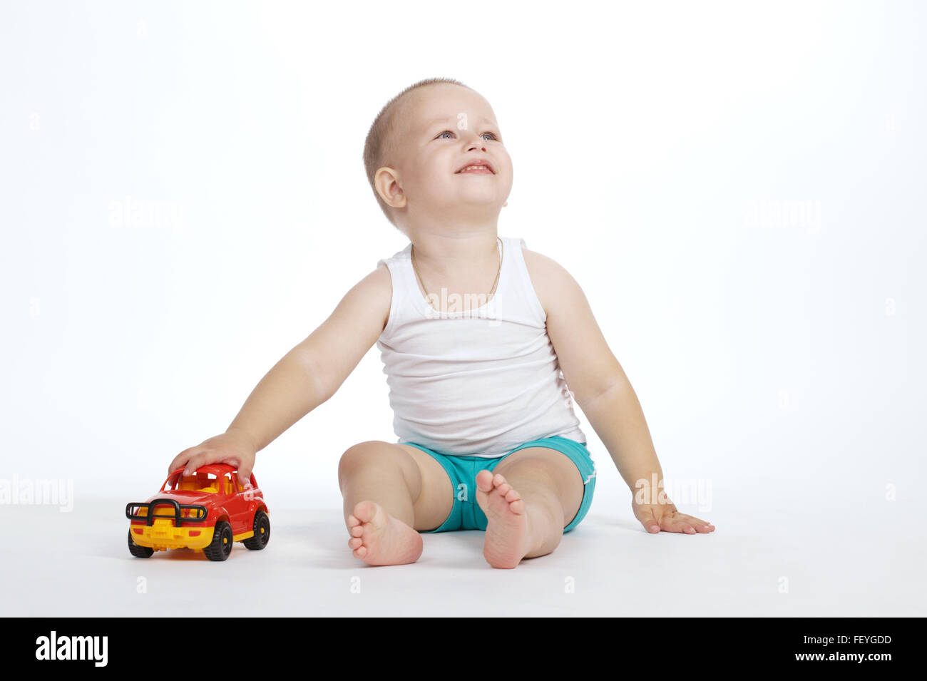 Little Boy With Toy Car : Little boy plays with toy car stock photo royalty free