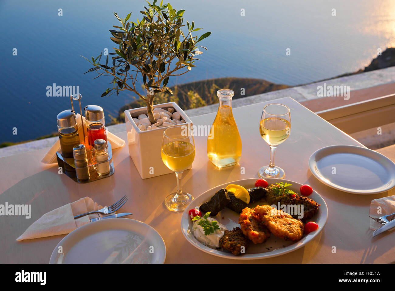 Romantic dinner for two at sunset.Greece, Santorini, restaurant on ...