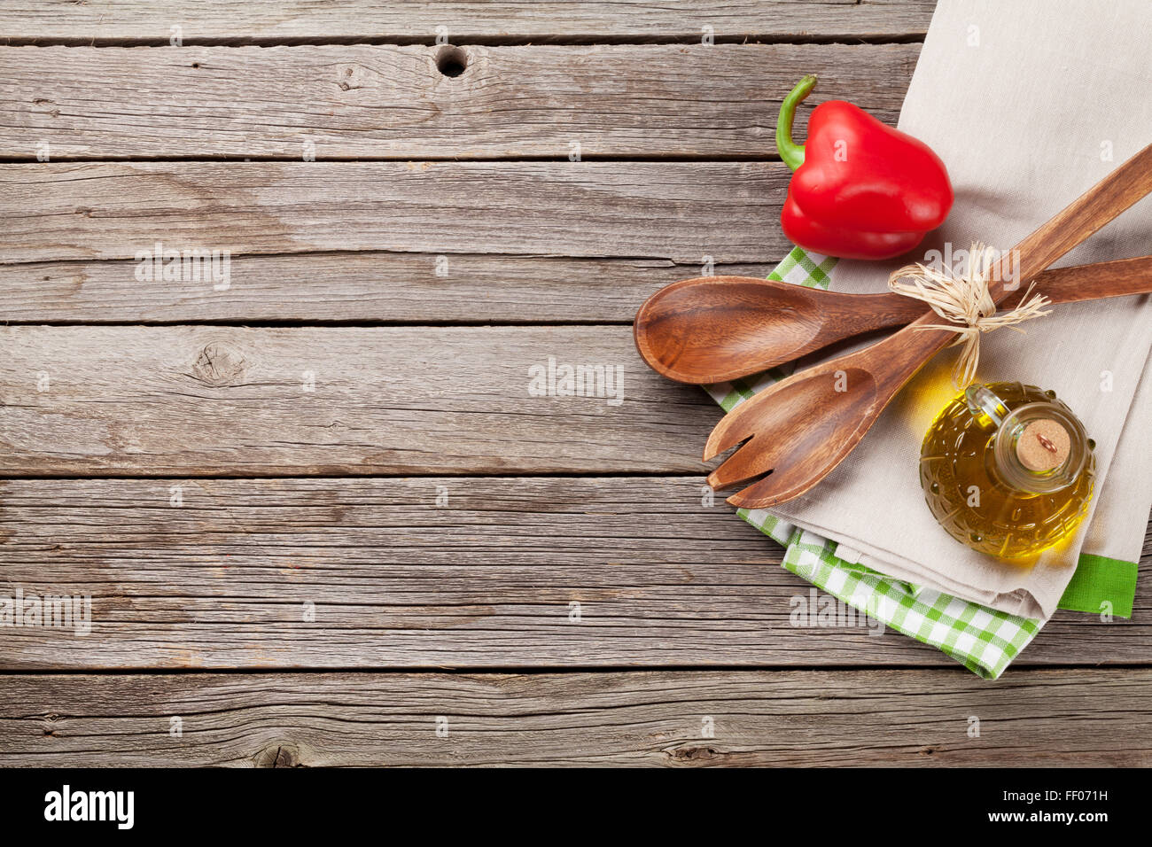 Cooking utensils and ingredients on wooden table top view
