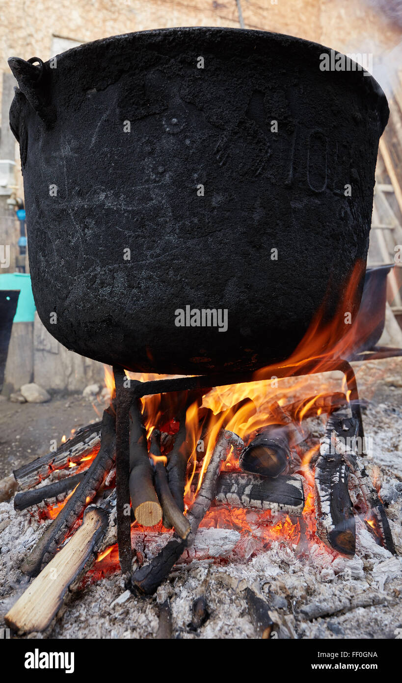 big cast iron pot boiling water outdoor in the countryside stock image