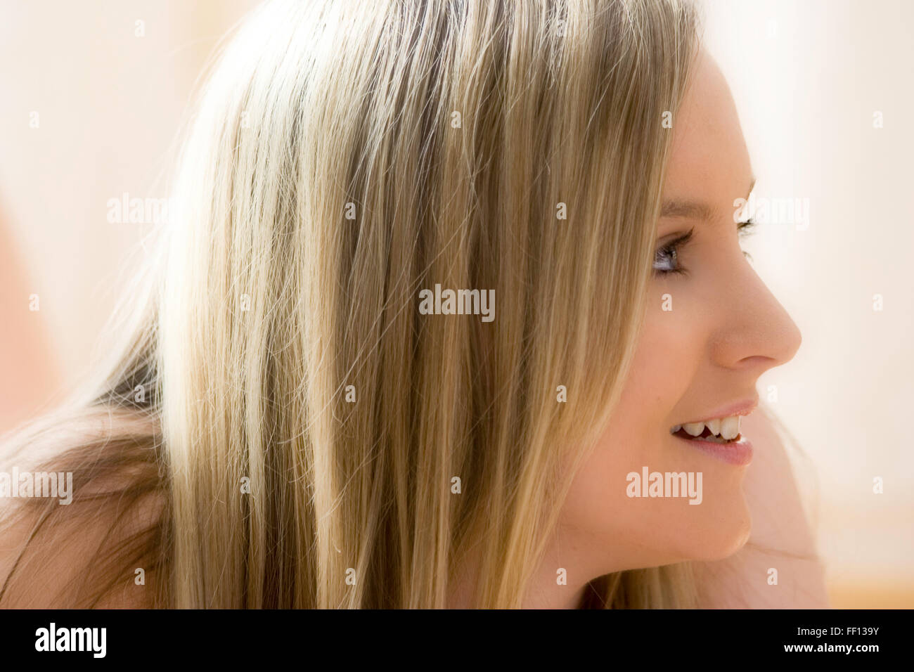 caucasian blonde blue eyed teenage girl face side view