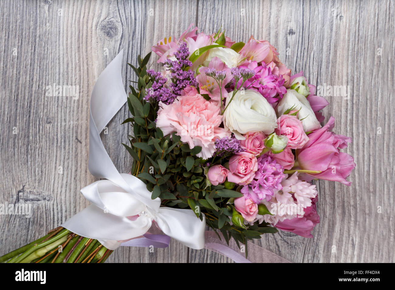 valentine bouquet of flowers on wooden background stock photo