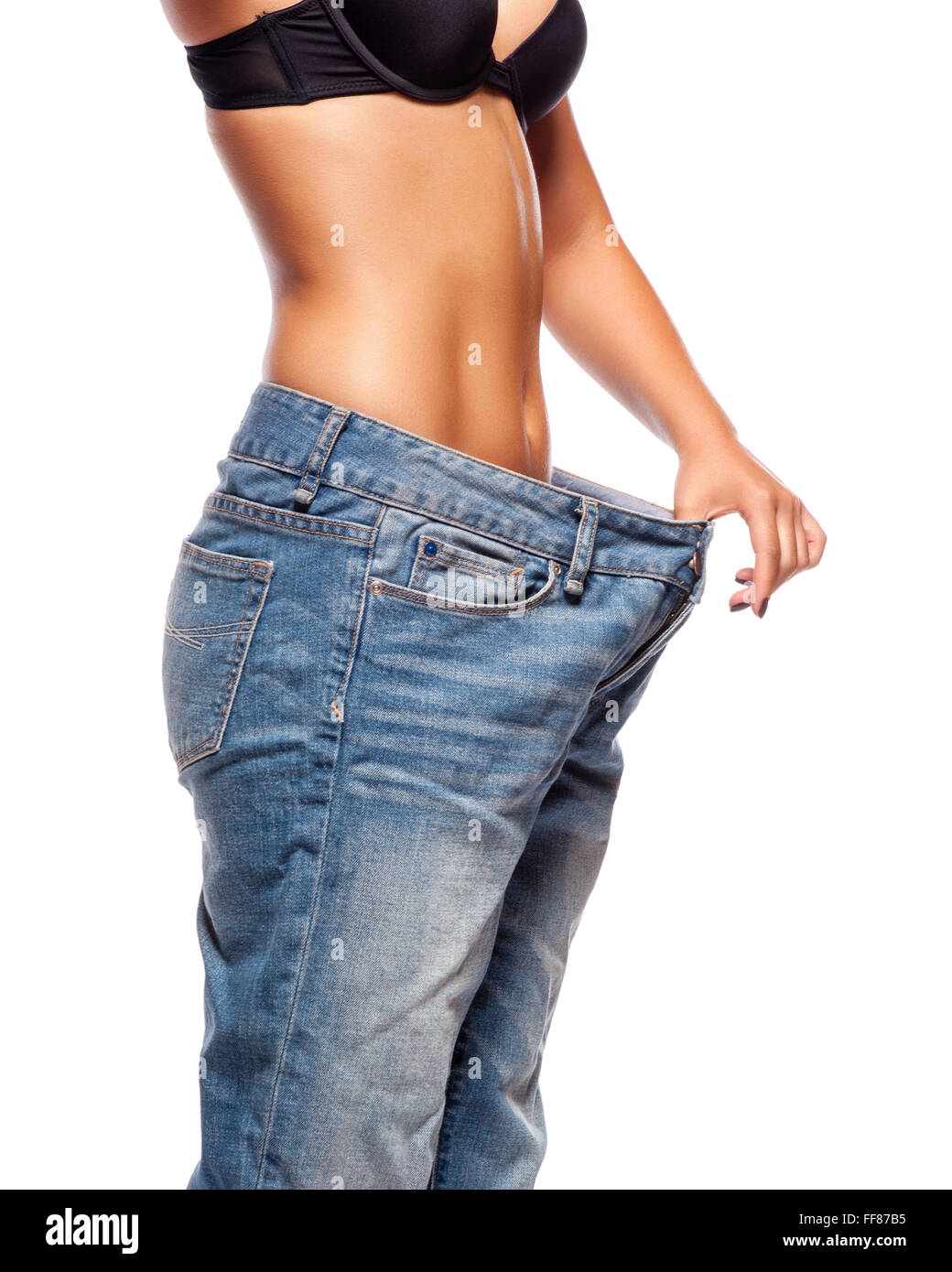 Background image too big - Close Up Of A Woman Belly In Too Big Pants Against White Background