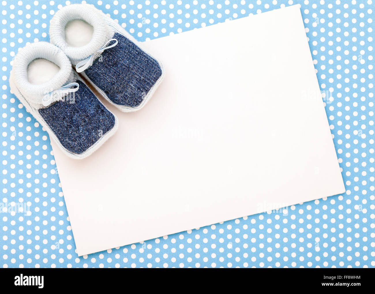 Announcement card with blue baby boy shoes on blue polka ...