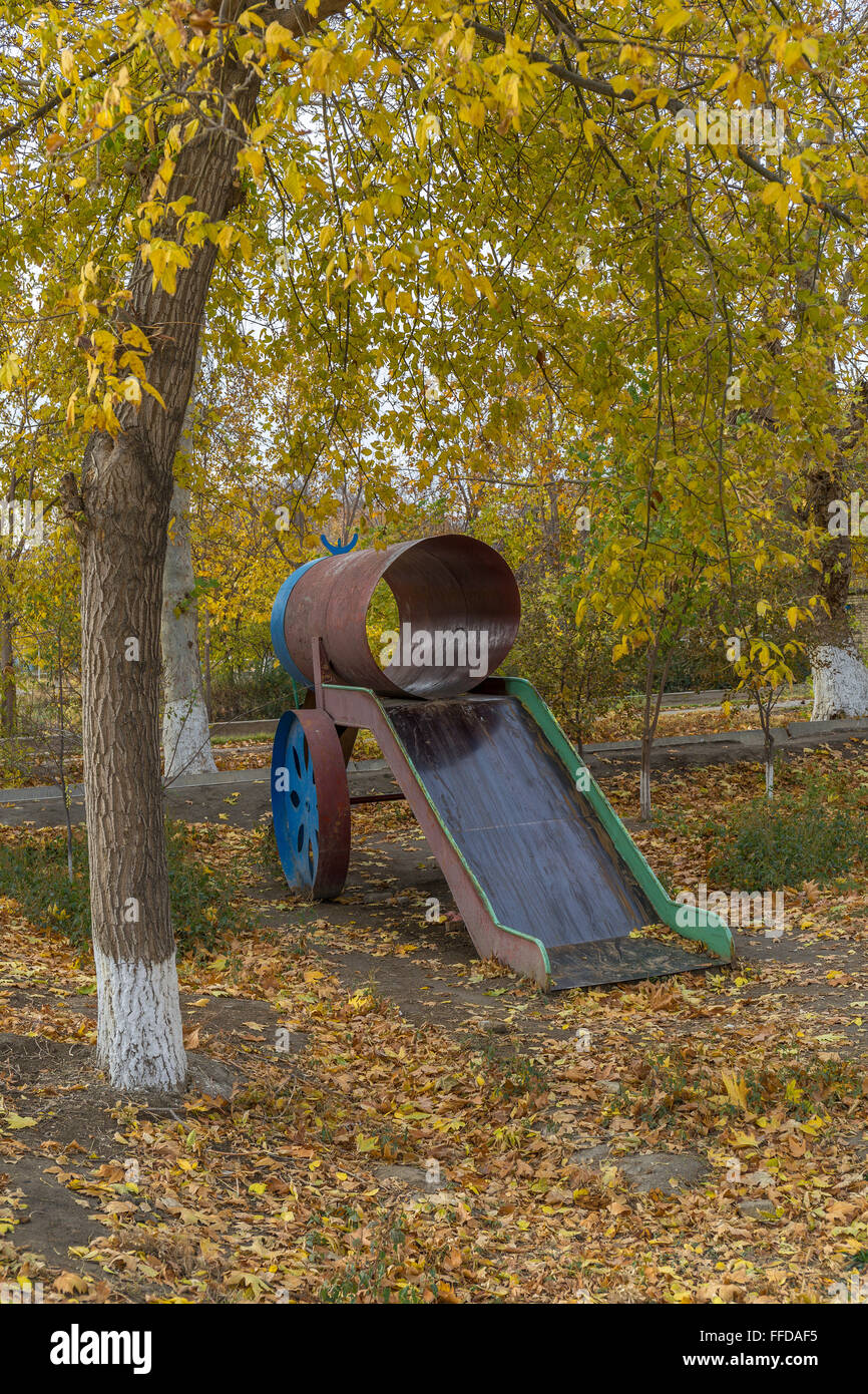 Makeshift child's slide in a central Bukhara playground ...