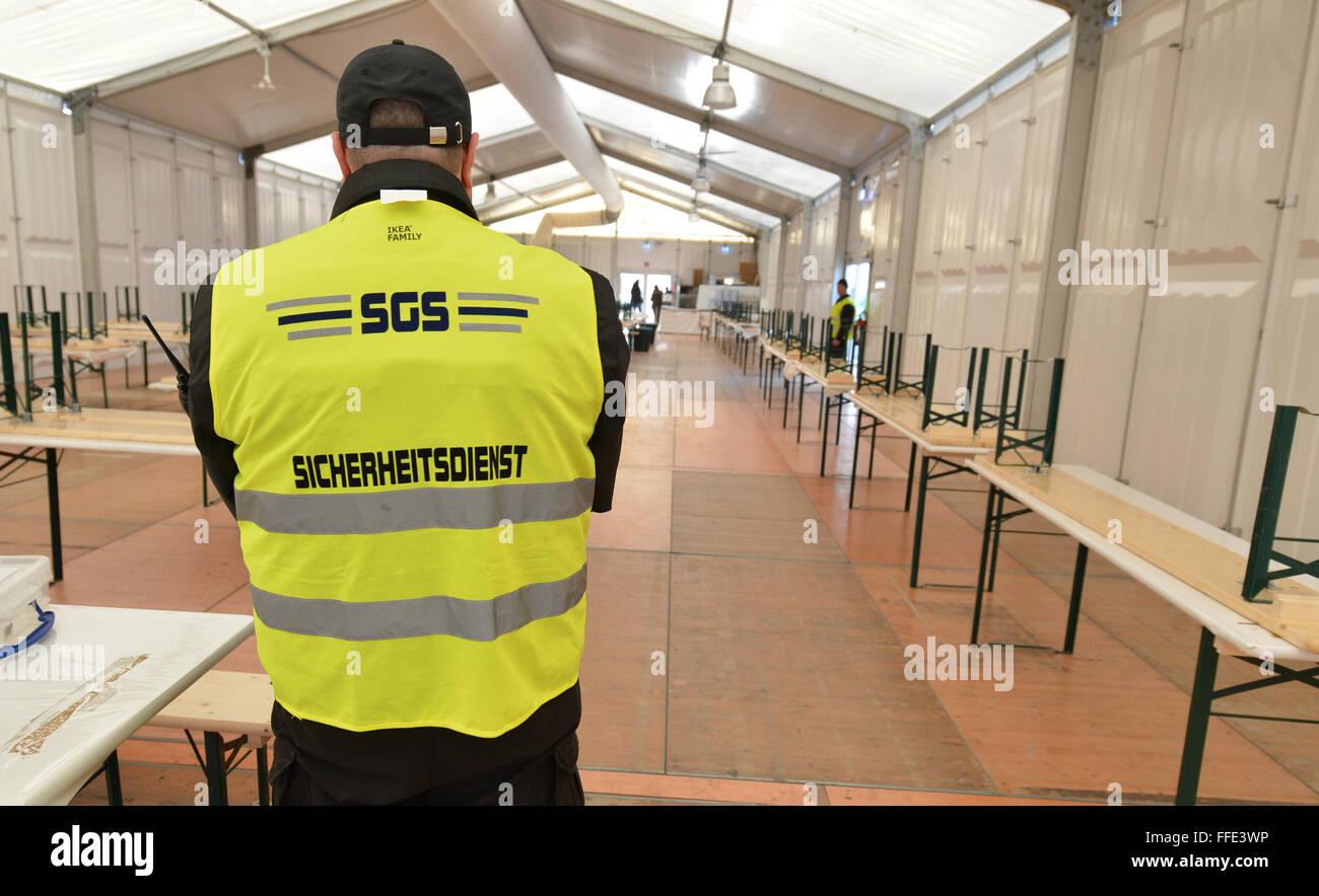 Stuttgart Germany. 12th Feb 2016. A security staff stands inside a tent & Stuttgart Germany. 12th Feb 2016. A security staff stands inside ...