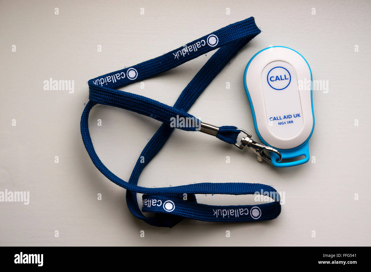 Call aid uk call panic button as pendant on a lanyard used by the