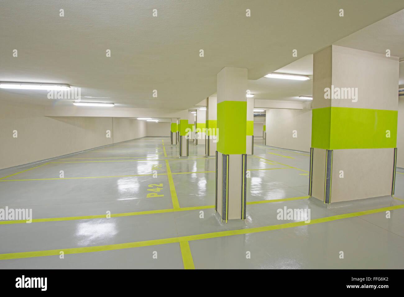 Design of basement car parking - Interior Of A New Modern Underground Car Park Beneath An Apartment Building With Columns Stock