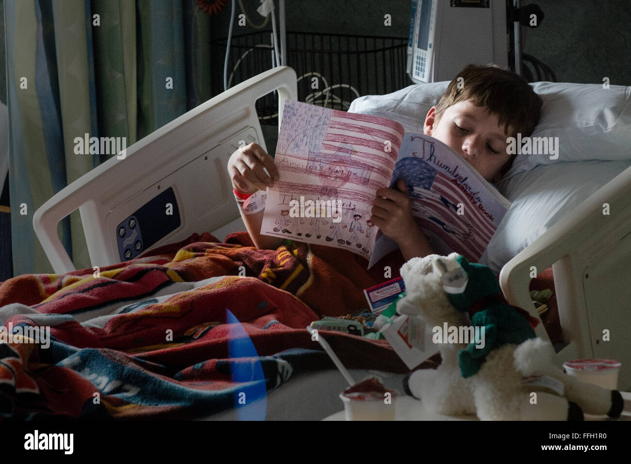 Childrens hospital coloring book - A Patient At The Golisano Children S Hospital Looks Through His Thunderbirds Coloring Book After Being Visited