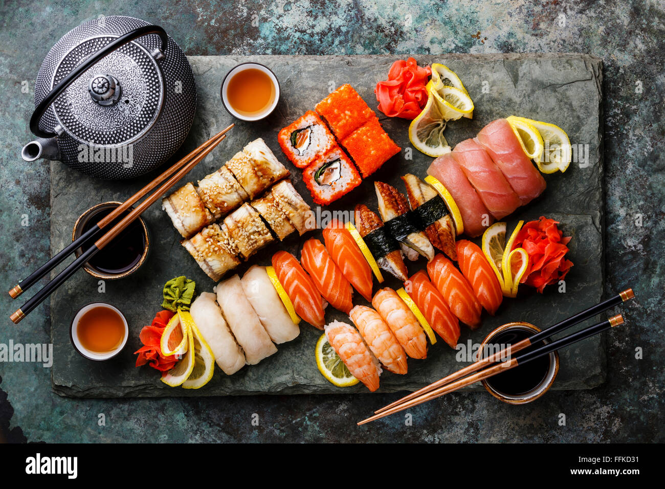 sushi set nigiri and sushi rolls with tea served on gray. Black Bedroom Furniture Sets. Home Design Ideas