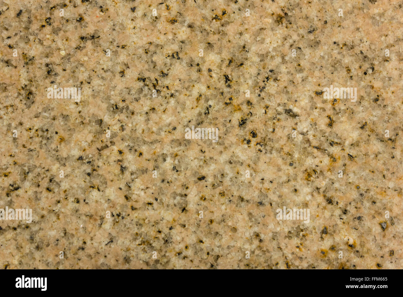 A Light Brown Beige Granite Counter Top With Flecks Of