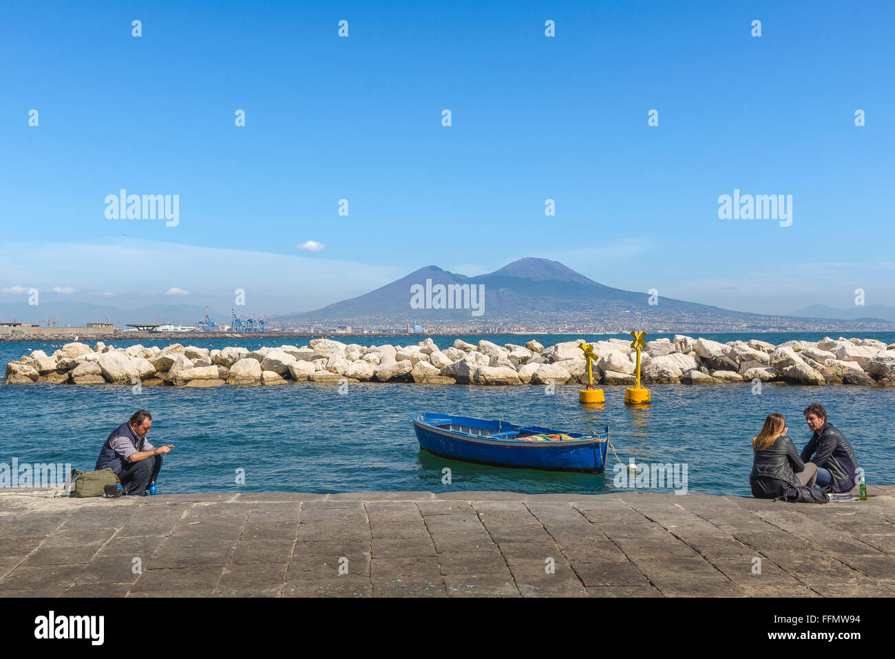 Bay Naples, against the distant form of Mount Vesuvius people ...