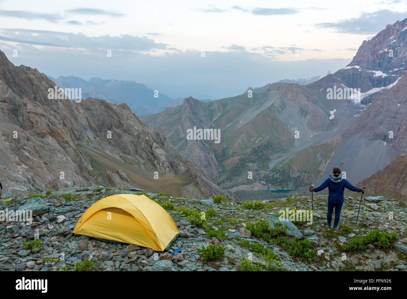 Hiker with walking poles and climbing tent & Hiker with walking poles and climbing tent Stock Photo Royalty ...