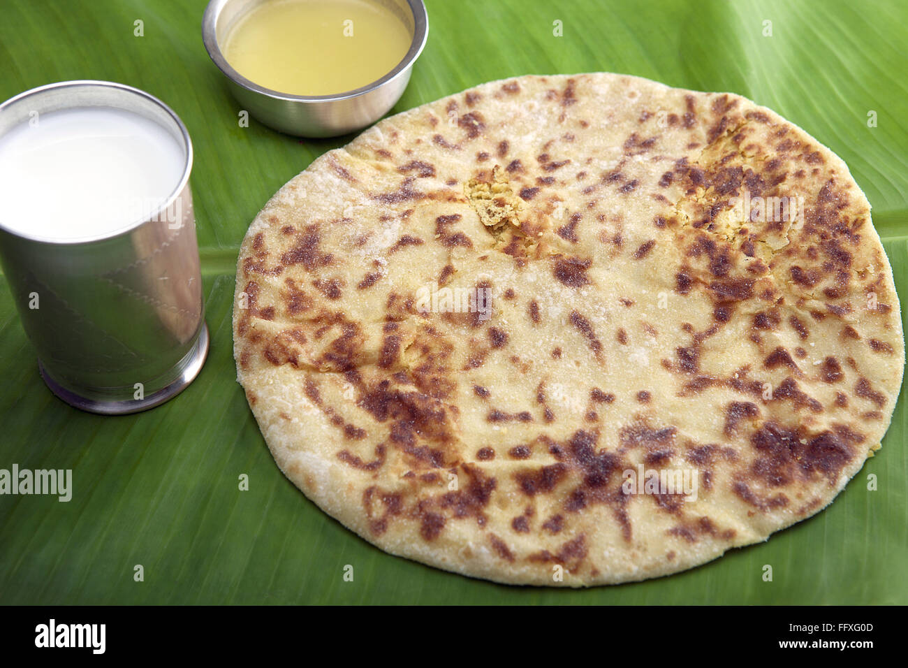 Puran Poli With Milk And Ghee On Banana Leaf