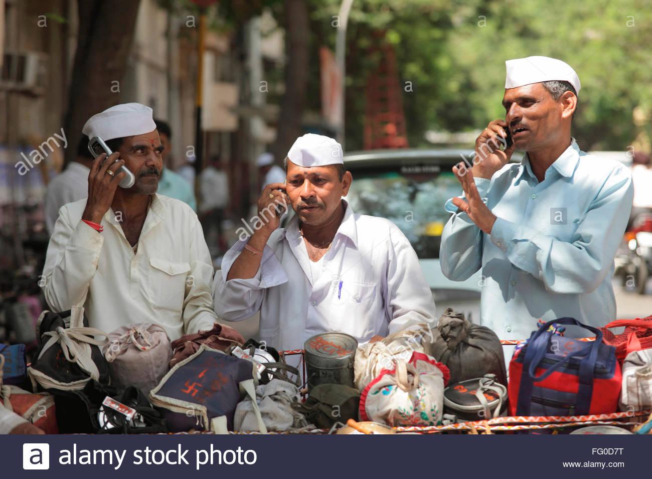 Indian dabbawala dabbawalla tiffin carrier talking on mobile at work of providing lunch boxes ; Bombay Mumbai Maharashtra  sc 1 st  Alamy & Indian dabbawala dabbawalla tiffin carrier talking on mobile at ... Aboutintivar.Com
