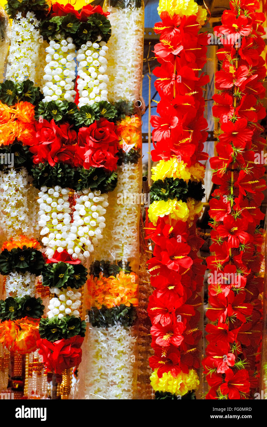 Colourful garlands of artificial flowers hang for sale used to ... for Flower Decoration Ideas For Ganpati  61obs