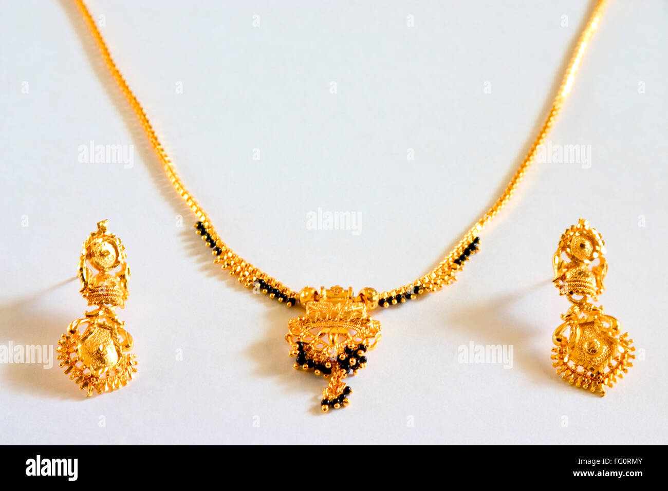 Concept gold black beads necklace mangalsutra hindu bride symbol concept gold black beads necklace mangalsutra hindu bride symbol marriage gold earrings imitation jewellery white background biocorpaavc