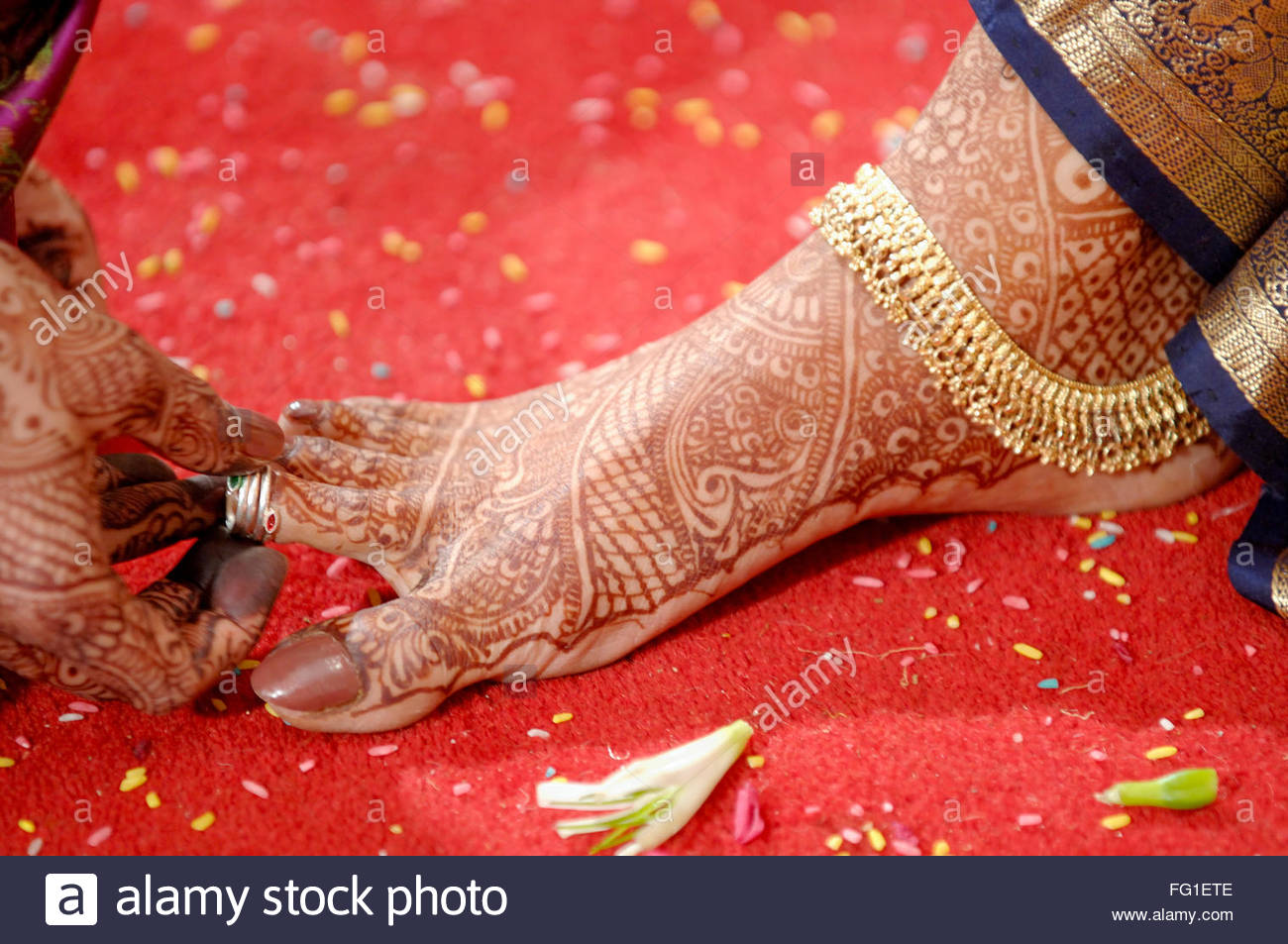 Marriage ornaments - Mehendi Ornaments And Toe Ring Around Ankle Offered To Bride By Mother In Law In Indian