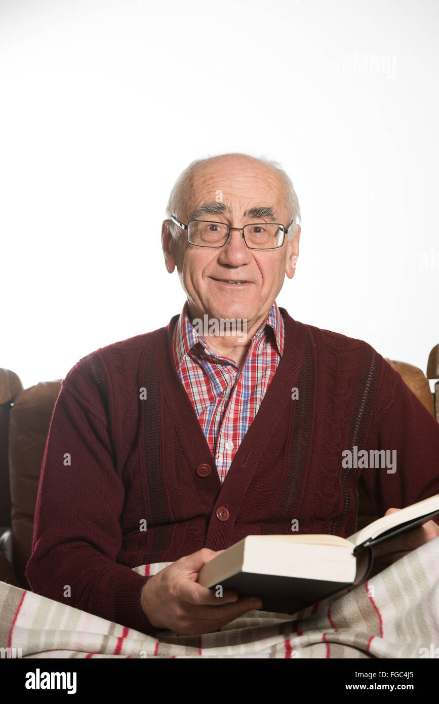 old senior man reading black book wearing red sweater Stock Photo ...