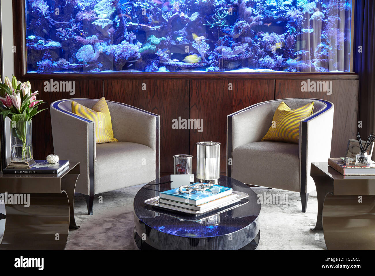 Sitting Room With Fish Tank And Captain Chairs. Tudor Hall, Potters Bar,  United Kingdom. Architect: Oro Bianco Interior Design L