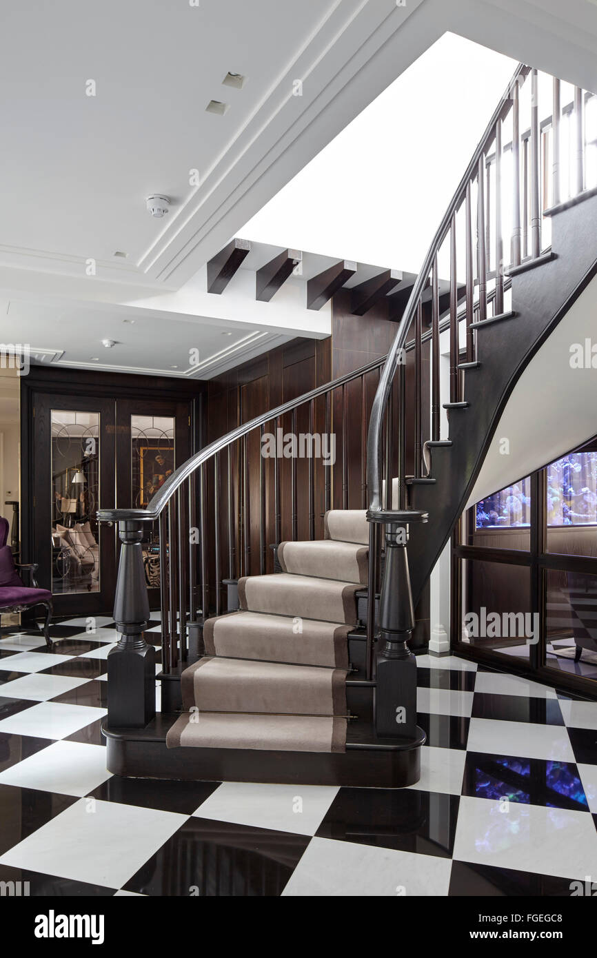 Curved wooden staircase with black white tiled floor in hallway curved wooden staircase with black white tiled floor in hallway tudor hall potters bar united kingdom architect oro bianc dailygadgetfo Image collections