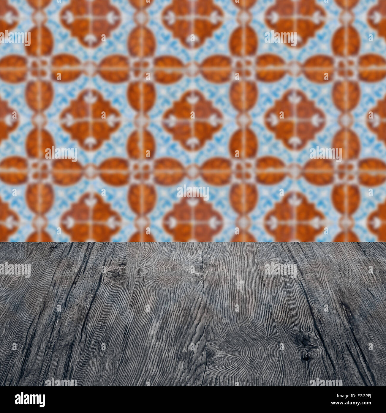 Empty wood table top and blur vintage ceramic tile pattern wall in empty wood table top and blur vintage ceramic tile pattern wall in background mock up dailygadgetfo Gallery
