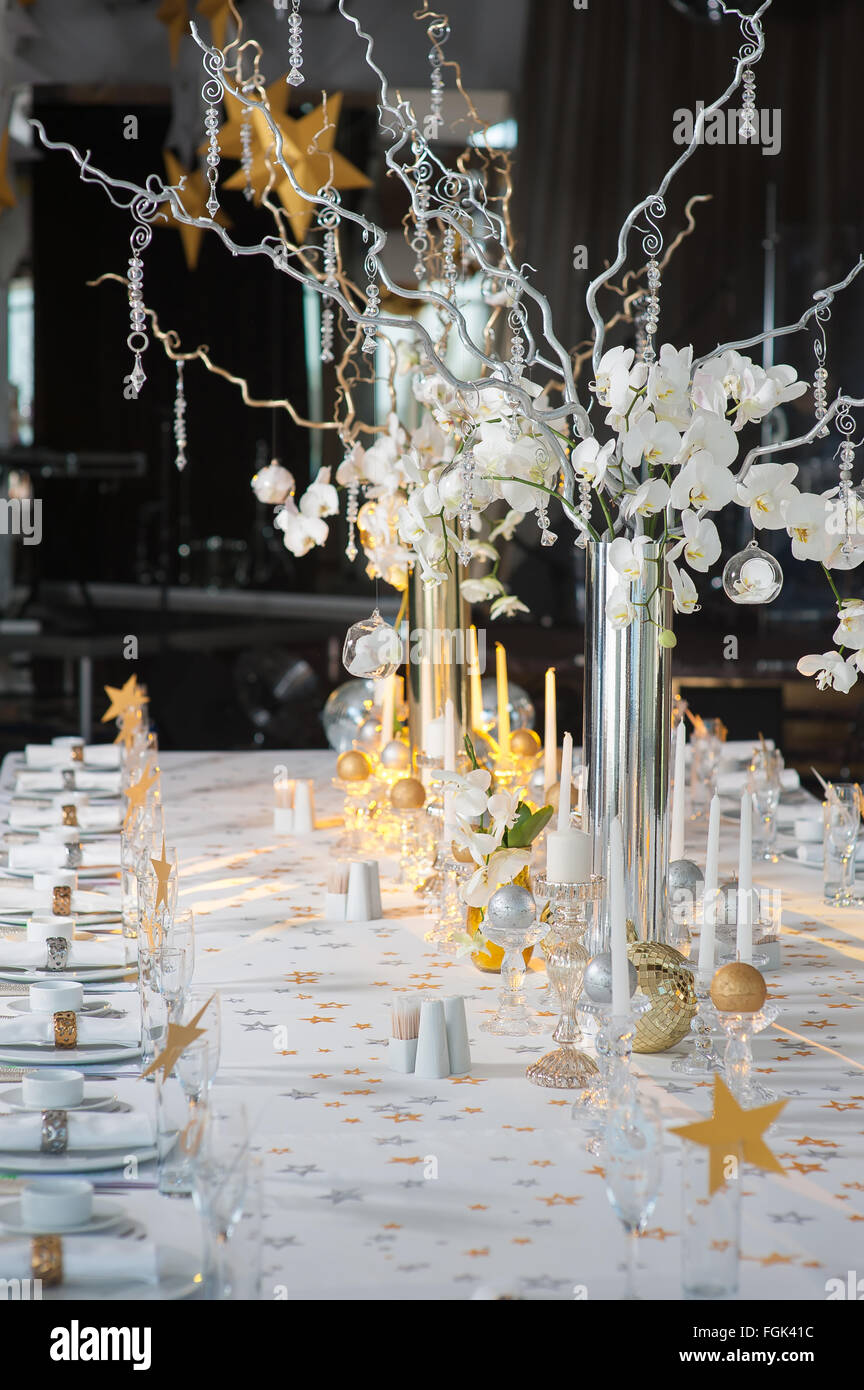 The branches of orchids in vases on the holiday table decorative the branches of orchids in vases on the holiday table decorative branch with crystal elements decorated table reviewsmspy
