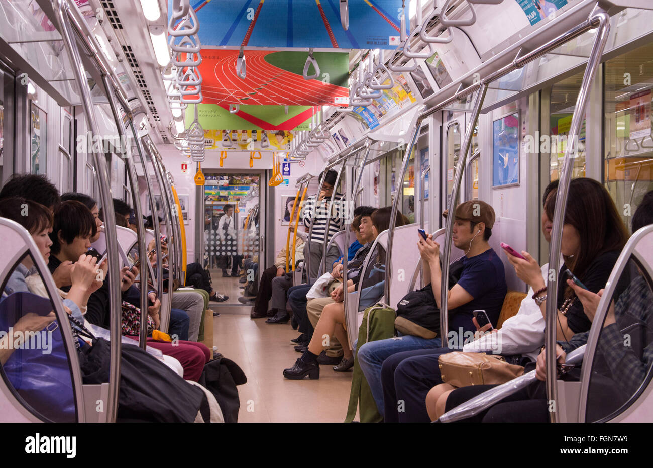 tokyo japan crowds subway car with locals going to work in crowded stock photo royalty free. Black Bedroom Furniture Sets. Home Design Ideas