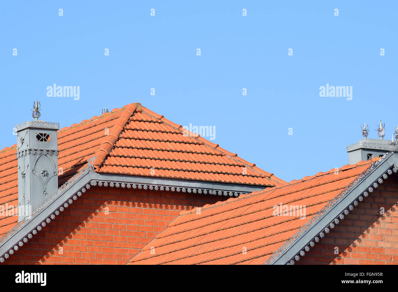 Stock Photo   The House With A Roof Of Tiles. The House With Gables,  Windows And Tiled Roof, Equipped With Overflow