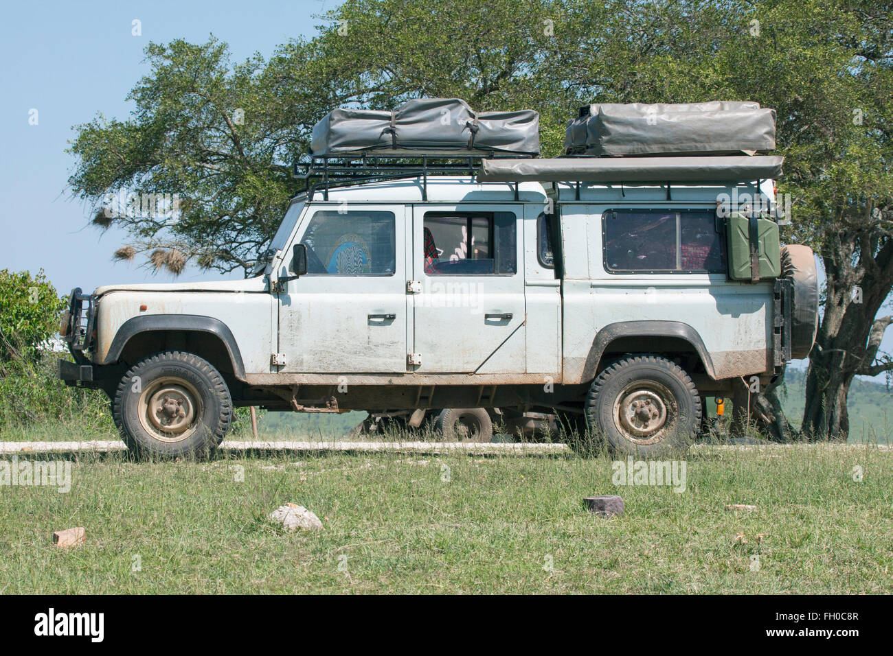 Old Land Rover Defender 110 with two roof tents Parked at roadside refreshment van Tanzania & Old Land Rover Defender 110 with two roof tents Parked at roadside ...