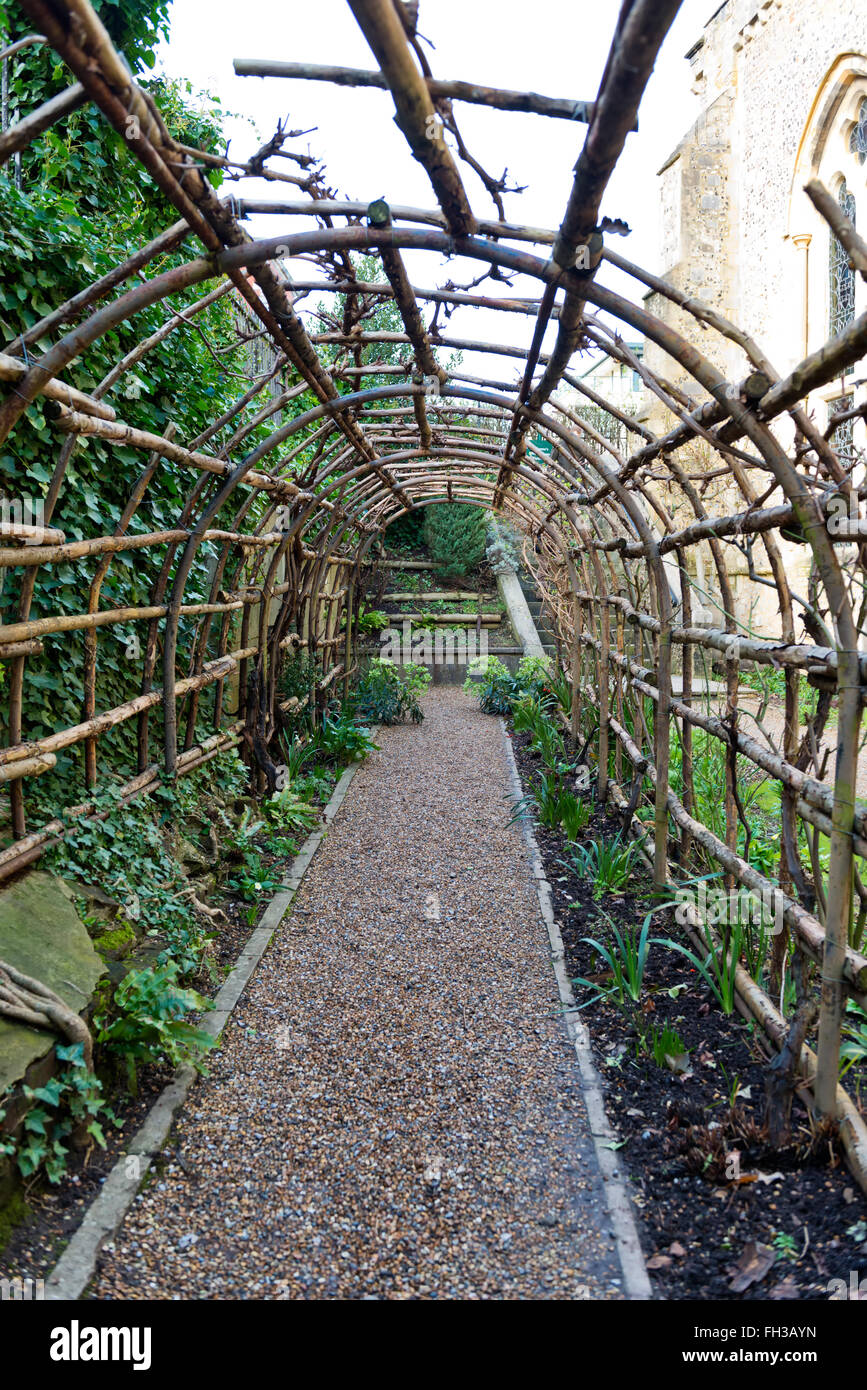 Interior View On Stone Path Of Empty Wooden Garden Trellis Outside Of The  Historic Winchester Castle In The United Kingdom