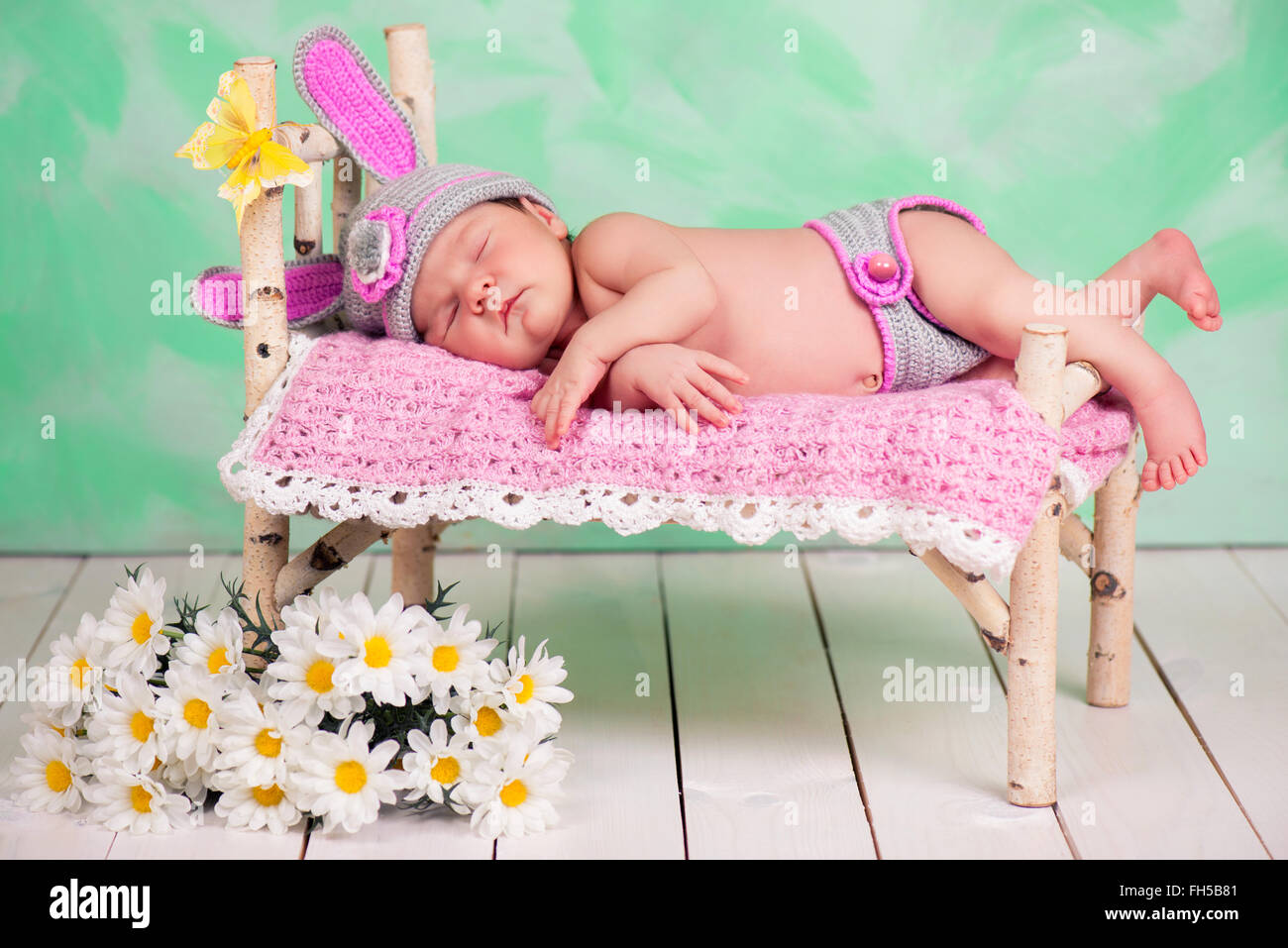 Wooden crib for sale in cebu - Newborn Baby Girl In A Knitted Hare Costume Sleeping On A Wooden Crib Birch Stock