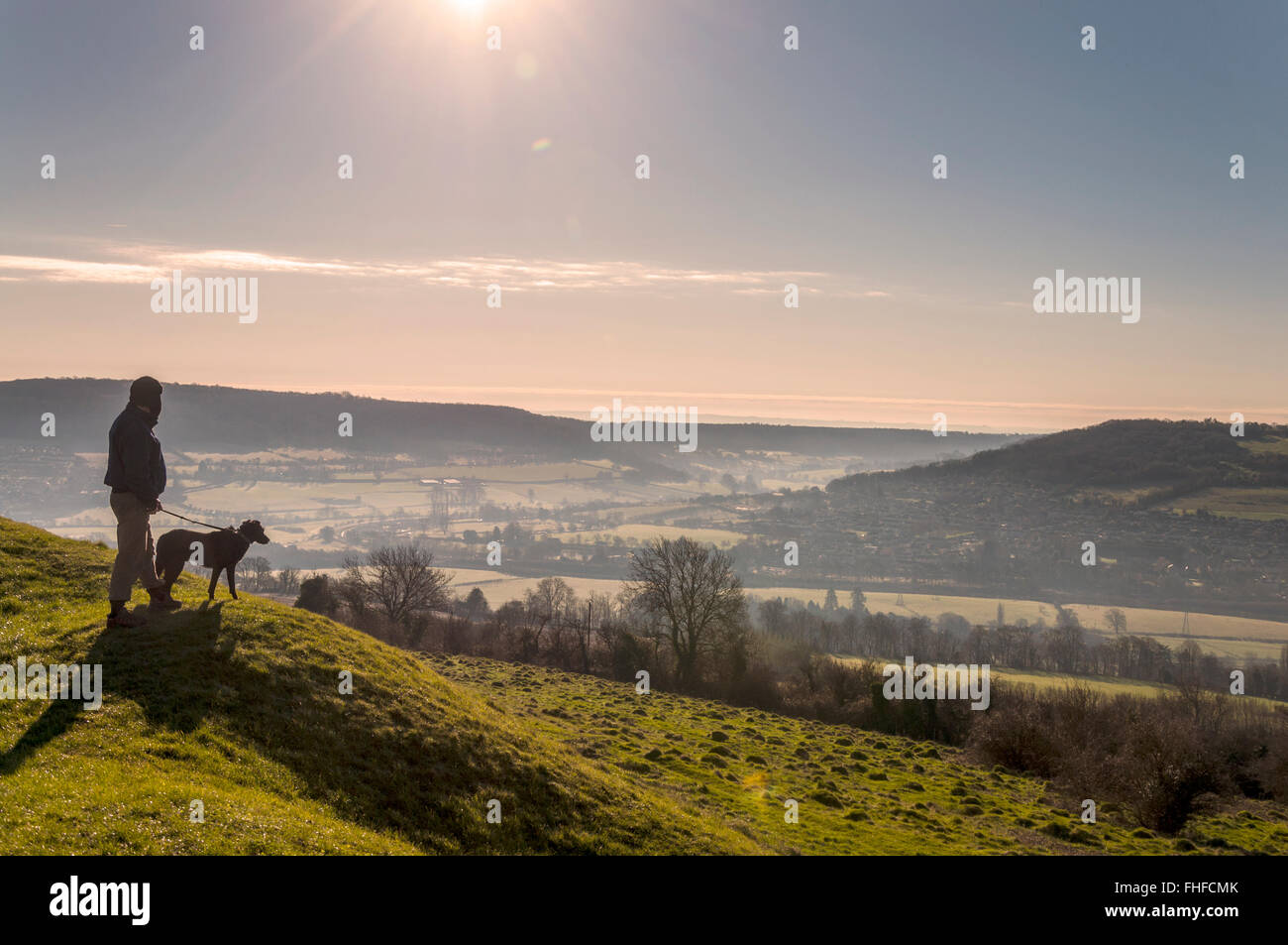 Little Solsbury Hill  Bath  Somerset  UK  25th February 2016  A dog walker  atop the old Iron Age fort made famous in the Peter Gabriel song  Solsbury  Hill Little Solsbury Hill  Bath  Somerset  UK  25th February 2016  A  . Dog Walkers Bath Area. Home Design Ideas