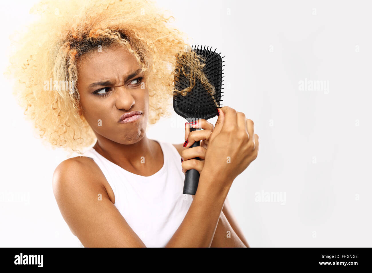 Dark skinned young woman combs her hair brush tangled hair dark skinned young woman combs her hair brush tangled hair combing hair urmus Choice Image