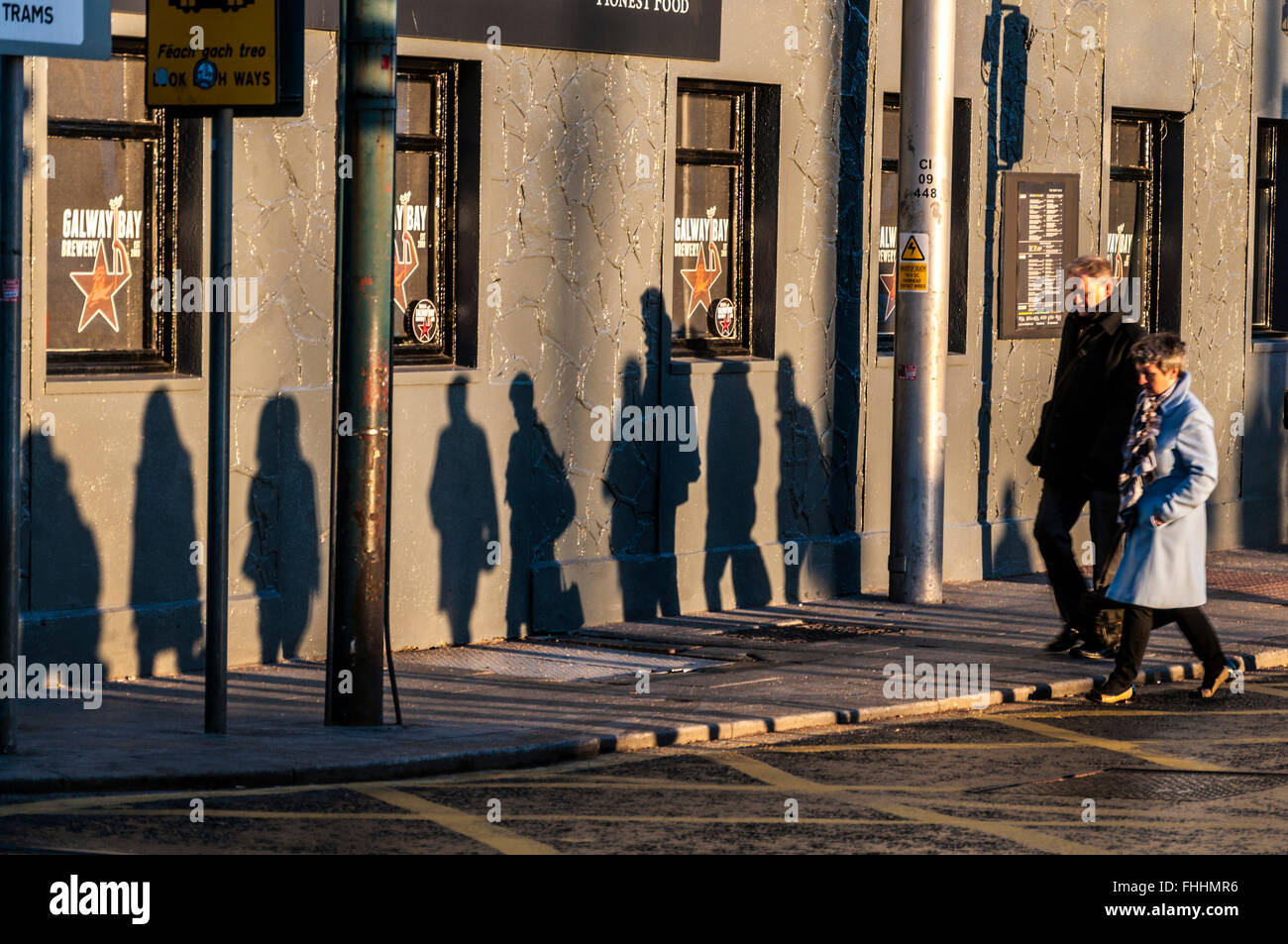 people shadows walking to work in dublin early winter people shadows walking to work in dublin early winter morning