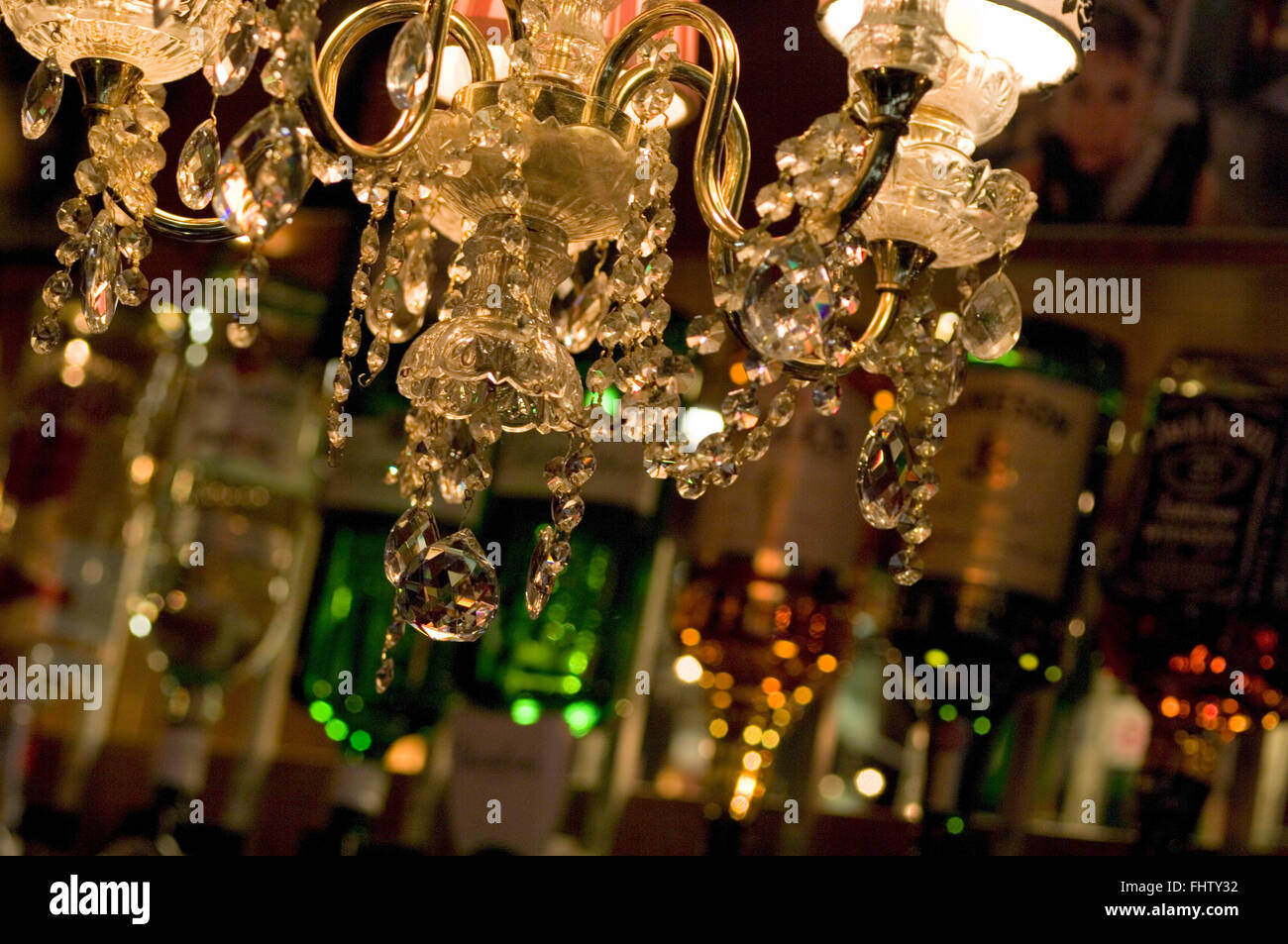Chandelier, crystals, lampshades and lamp sparkling in a pub with ...