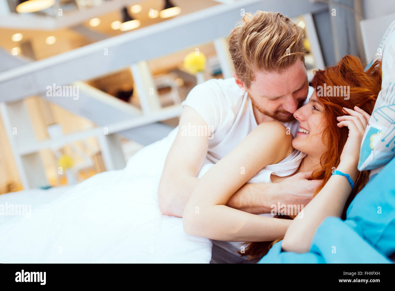 Romantic couple in love lying on bed and being passionate   Stock Photo. Romantic couple in love lying on bed and being passionate Stock