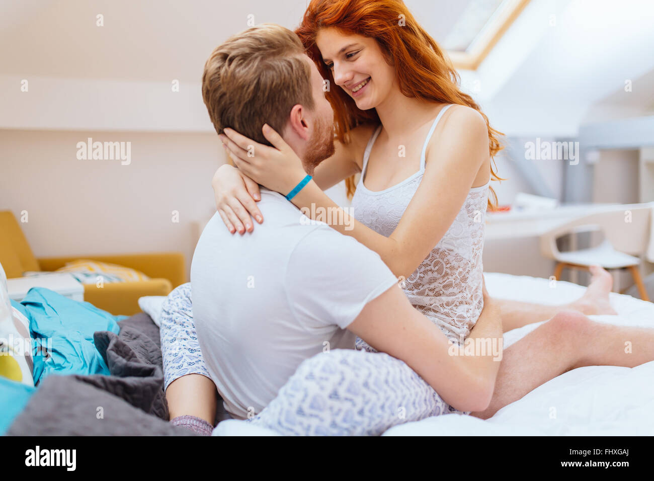 Romantic couple in love lying on bed and being passionate. Romantic couple in love lying on bed and being passionate Stock