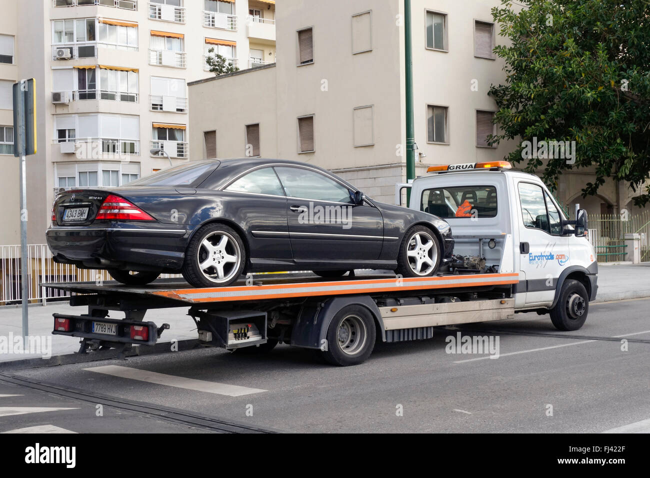 Luxury car on flatbed tow truck spain stock image