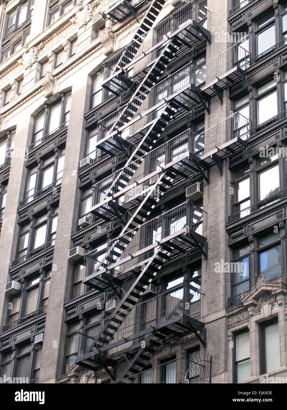 Fire escape stairs on the side of a new york apartment for Buying an apartment in nyc