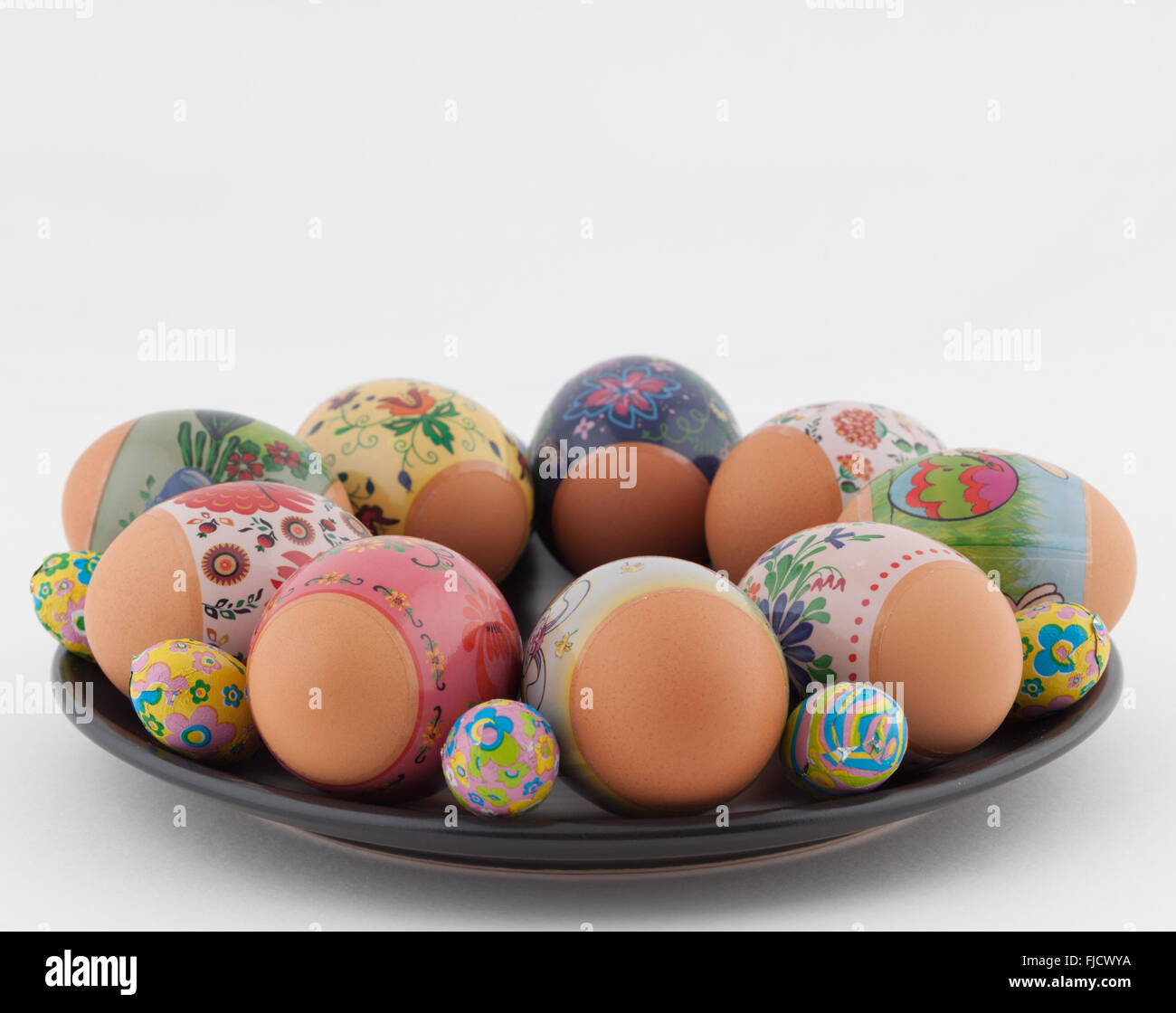 Easter Eggs And Chocolates On Black Plate Closeup