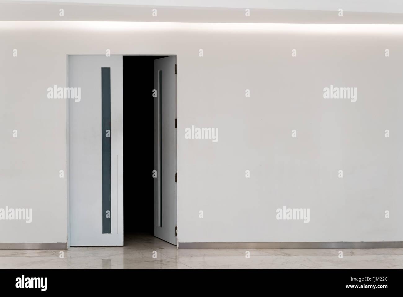 Open Door Dark Room door open into dark room, with copy space stock photo, royalty
