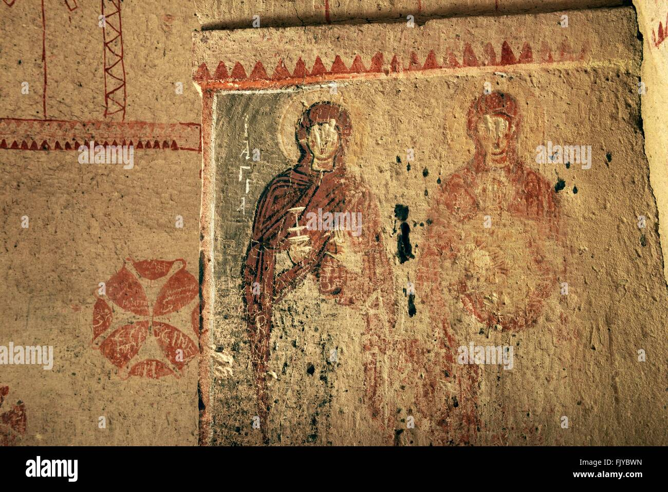 Early christian mural saints defaced gouged eyes in for Christian mural