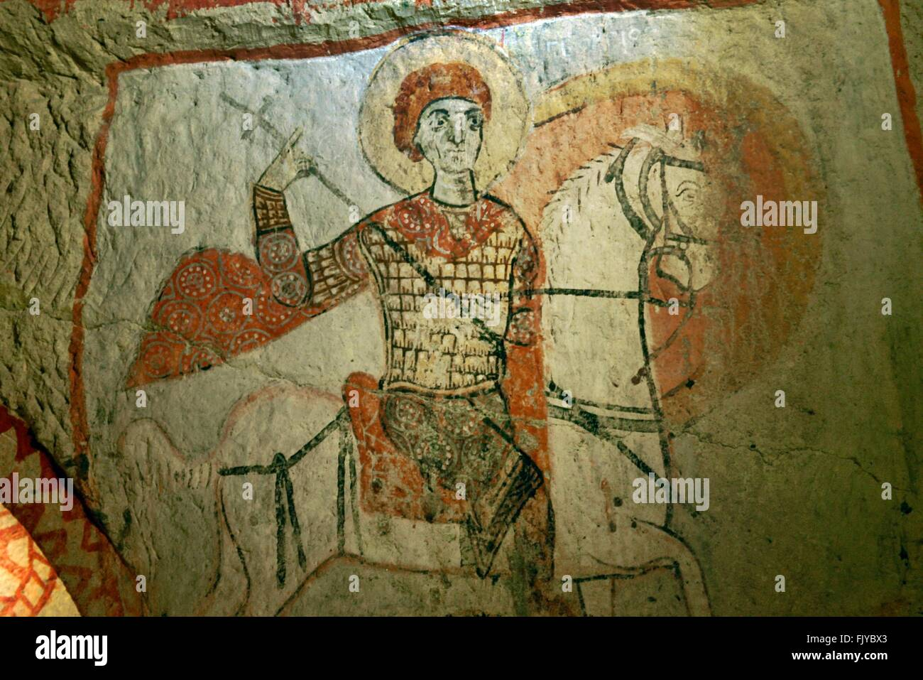 Early christian mural saint george slaying dragon in rock for Christian mural