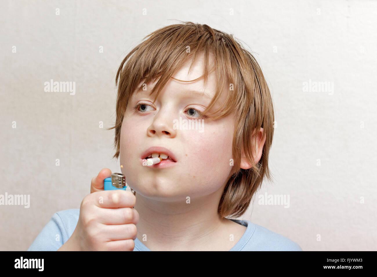 underage smoking Stock Photo - underage boy smoking