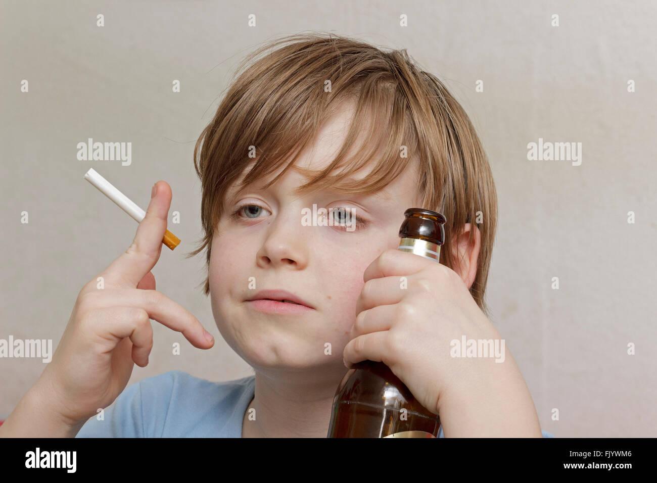 underage smoking Stock Photo - underage boy smoking and drinking beer
