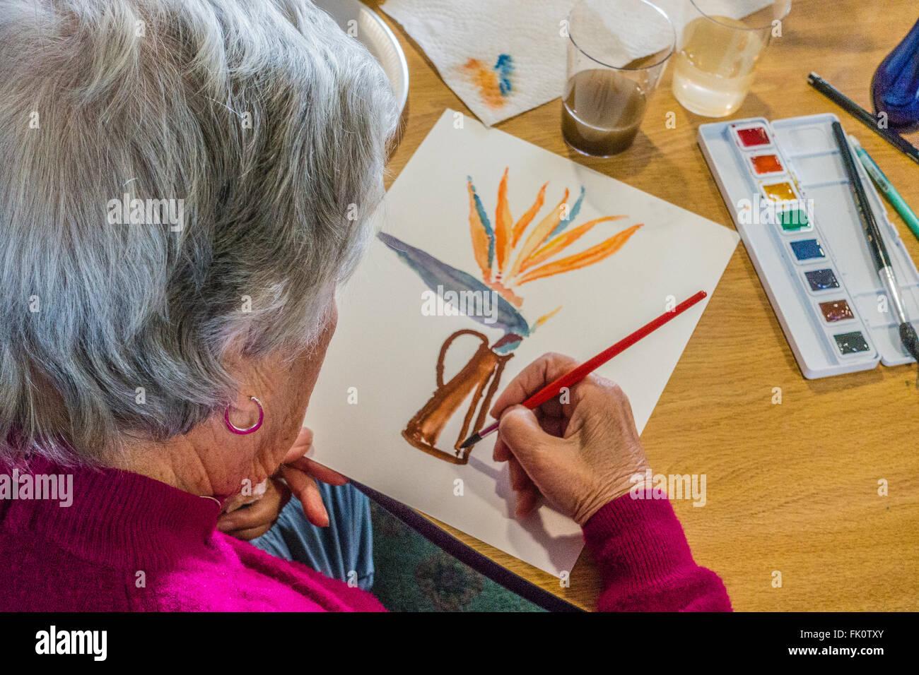 A Female Senior Citizen Paints In A Watercolor Class For Seniors At Garden  Court Senior Residence In Santa Barbara, California